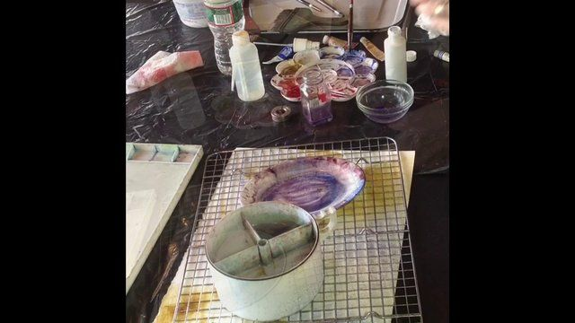 A short video by Chris Carter showing one of her many methods of creating textured layers in her watercolors.  In this video she uses a wire, cookie rack as a template, applies the paint with a mouth atomizer and creates added texture with plastic wrap.  Music: As I Figure by Kevin MacLeod (http://incompetech.com)