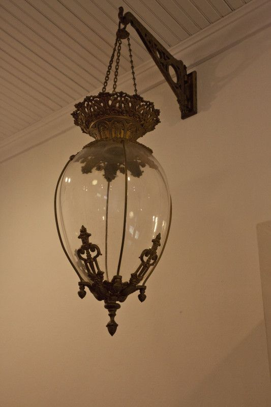 what is a lighting fixture. an antique light fixture hanging from a wall at the cedar key historical society what is lighting y