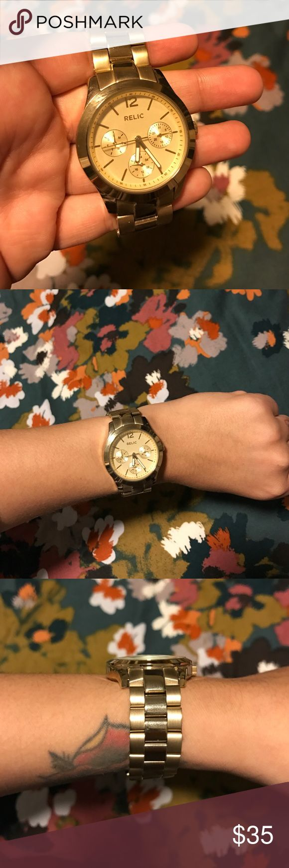 Relic gold fashion watch Similar in looks to Michael Kors. This is a fraction of the price. Relic watch. Excellent cond. have all the extra links. No scratches on the face. And minimal wear on the band. Relic Accessories Watches