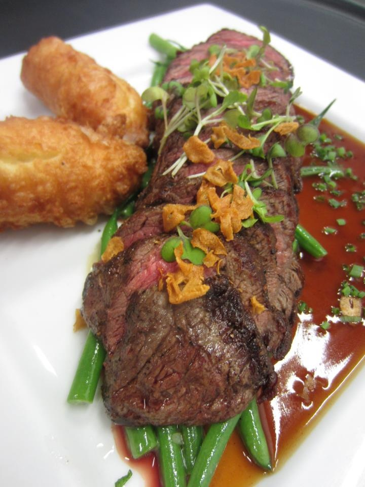 Delicately seared Coulotte Steak paired with haricot vert, dauphine potatoes and Chef Thad's savory veal, beef and red wine reduction.  http://logan-restaurant.com/