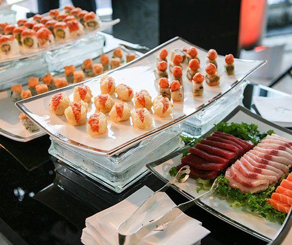 Wedding Reception Food Trays: Bite-sized Indulgences Of Sushi And Sashimi Are