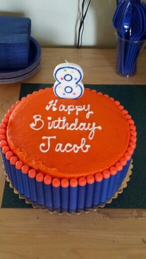 Nerf themed birthday party-store bought cake with Nerf bullet s glued onto side with icing.  Wash off after cake cutting and use in Nerf war.