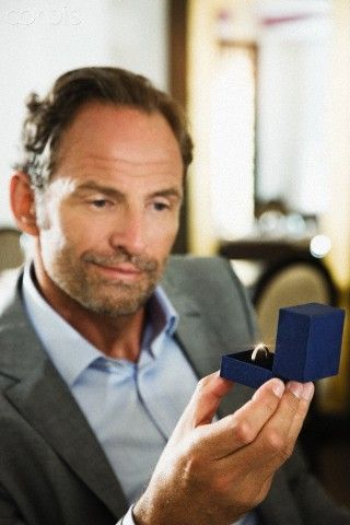 Businessman looking at engagement ring