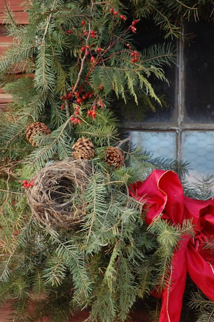 Little birds nest attached to a Christmas wreath