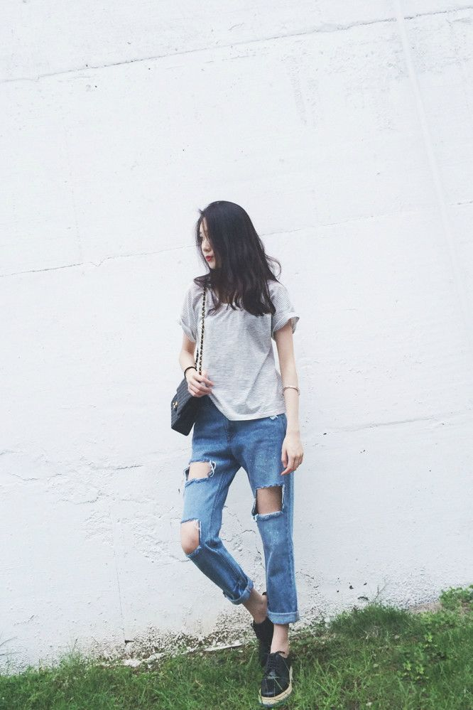 Basic tee & boyfriend jeans , together with a small black bag