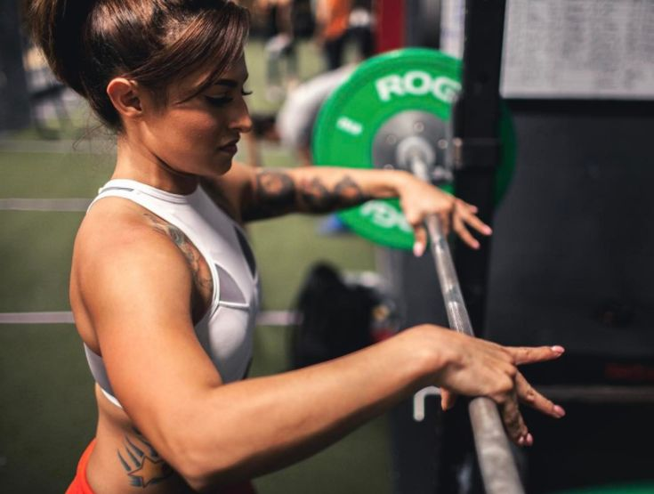 Everything you ever wanted to know (and should know) about the back squat, specifically high bar vs low bar back squats and which is best for your goals.