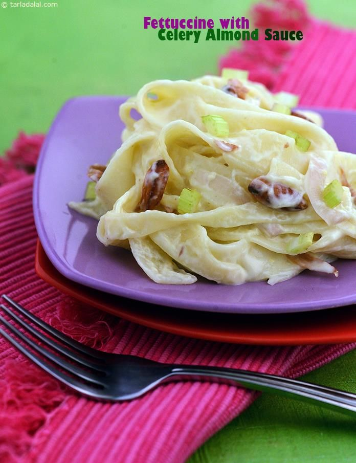 Fettuccine with Celery Almond Sauce, here is a rare leaf out of italian cuisine! ribbon-like strands of fettuccine are dunked in a creamy mustard, celery and almond sauce to present a memorable treat.