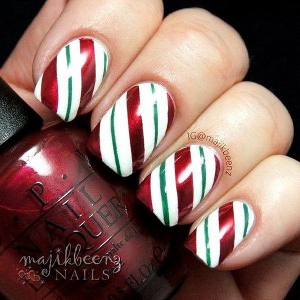 Nice Stripped Christmas Nail Art Designs.                                                                                                                                                                                 More