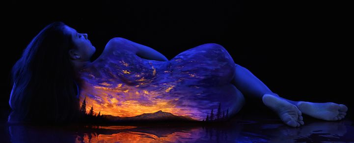 Photographer and artist John Poppleton specializes in creating fantastical works of art painted directly on the human body. His Black Light Bodyscapes consist of gorgeous nature scenes painted with fluorescent pigments on the backs of female models, who are then photographed under black light to produce these extraordinary images. Featuring spectacular phenomena such as oceans during sunset, mountain ranges under moonlight, shimmering auroras, and even cosmic scenes of stars and galaxies…