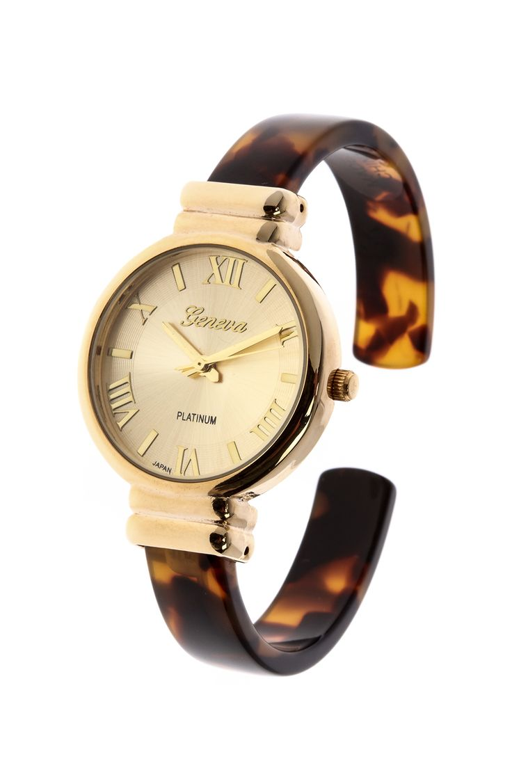 Tortoise shell cuff watch with an adjustable hinged cuff fits most wrist sizes. Watch face is trimmed with gold and clearly displays roman numeral numbers to read the time.  Approx. Measures: 1 cm wide band.  Tortoise Shell Watch by Light Years Collection. Accessories - Jewelry - Watches North Carolina Chapel Hill North Carolina