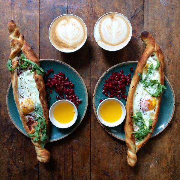 """Turkey: Pide""""A friend of mine, John Gregory-Smith, has just released a new book, Turkish Delights, with some wonderful pide recipes. It's pretty much a long, folded pizza but with an egg dropped in before going into the oven. Breakfast perfection, I say."""" #refinery29 http://www.refinery29.com/2015/12/98897/breakfast-recipes-around-the-world#slide-1"""