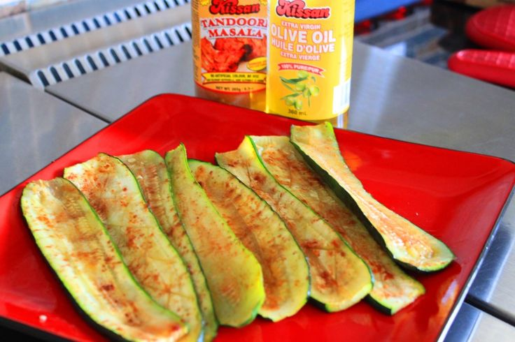 Easy, delicious and healthy Tandoori Baked Zucchini slices recipe from cookingwithkissan.ca . Complements steak, chicken, beef,  lamb, chicken and seafood. #kissancanada #kissaninternational #baked #zucchinirecipes # eatveggies # tandoori #vegan #veganfoodshare #eathealthy #