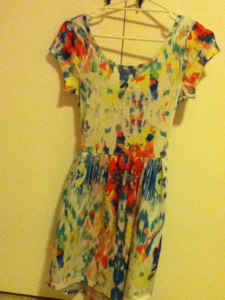 7 - colourful, rainbow, open-back dress. looks a lot duller in the picture than it actually is. Valleygirl, size 10.