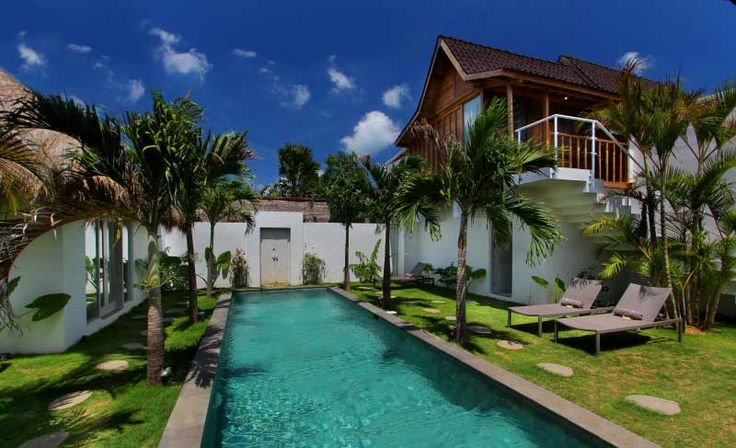#pool view of the property with a #bungalow on the left and a #gladak on the right.