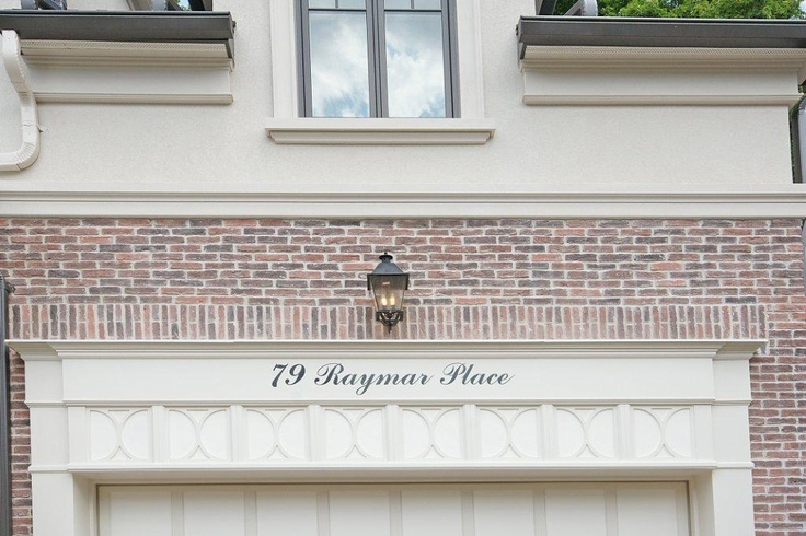 Great use of space on garage mouldings to incorporate the address.