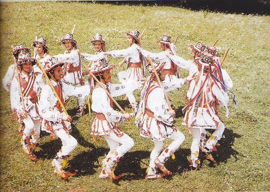 This image depicts a group of Romanians in their traditional activities. During these activities large groups of people come traditionally dressed to dance, sing and share happiness. Those are the main characteristics that mark rural Romania's traditions, such traditions rarely occur in urban Romania at this point.