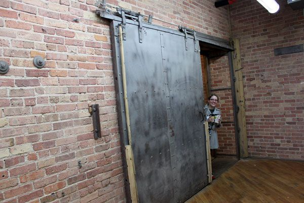 Warehouse industrial sliding door. This is exactly the door I have been picturing for Casey's apartment.