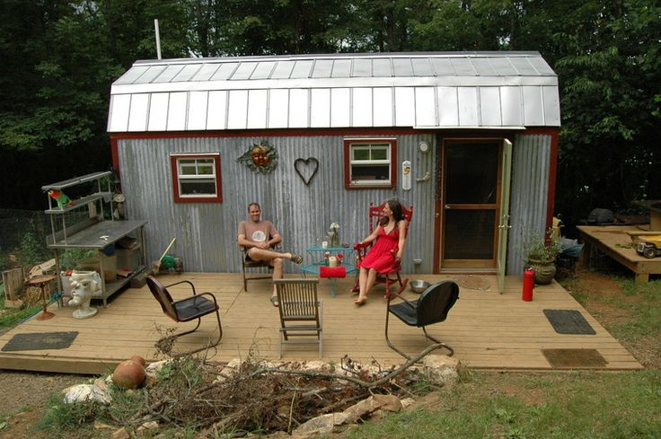 """""""We are a family of four (plus one large dog and one cat) living in 168 sq. ft., plus sleeping lofts. The tiny house is our first structure on our small, mortgage-free homestead. In order to move onto our land and live rent and mortgage-free as soon as possible, we decided to build a tiny house. The solution was a good one. We have lived in our tiny house full-time since May of 2011 and can report that our lives have been deeply enriched by this lifestyle."""" I like their planter"""