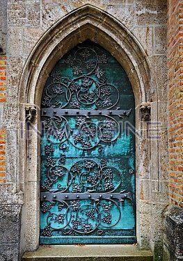 Gothic door with iron mounting at the neo-Gothic St. Ottilien Archabbey,near Landsberg,Bavaria,Germany.