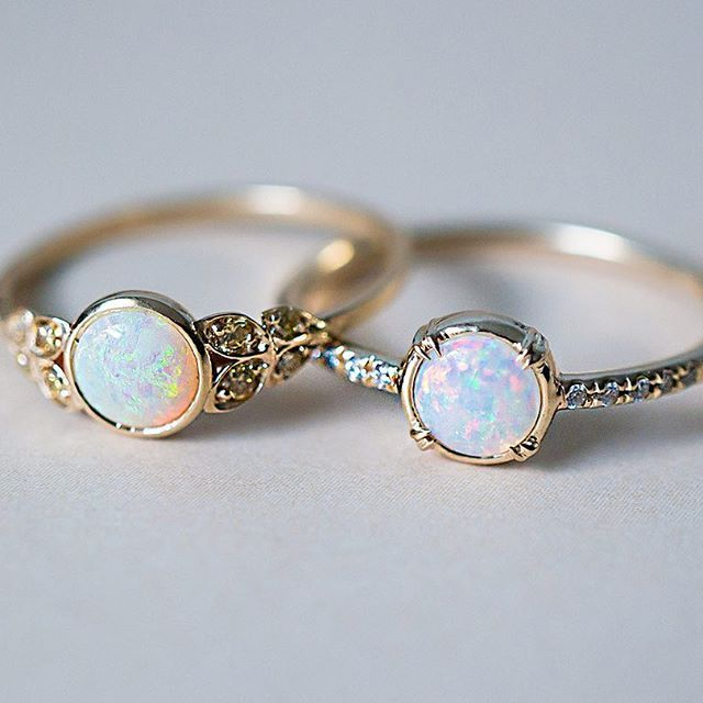 http://rubies.work/0095-ruby-rings/ While we're on the subject, here are our two Australian Opal beauties side by side. Our Edwardian inspired ring with Yellow Australian Diamonds and our Else Secret Diamond ring with a gorgeous 5mm white Opal. ✨ both rings are Recycled 14k Gold and handcrafted here in freezing cold NYC. #opalsaustralia