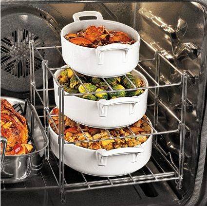 Expandable oven rack - sur la table $9.99. Anyone who has cooked Thanksgiving/Christmas meal knows this is absolutely necessary if you have a single oven!!