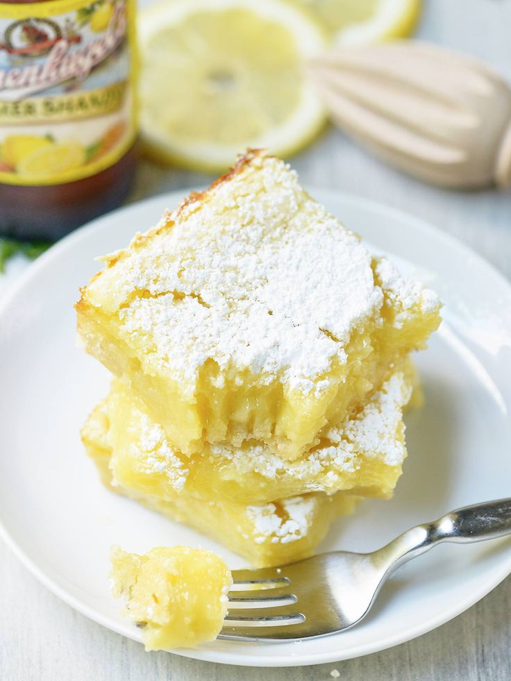Summer Shandy Lemon Bars! The base is a simple shortbread crust. It's rich, buttery, and perfectly sweet. The filling is a twist on a classic. It's light, lemony, and the Summer Shandy comes through beautifully.