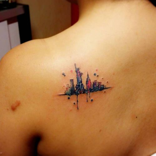 Watercolor style New York skyline tattoo on the left shoulder...