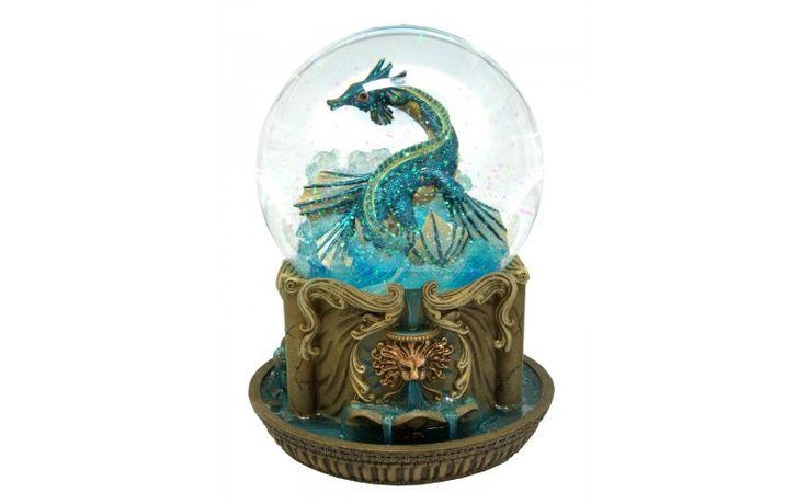 Dimension: 120 mm.  Fonction: musique, rotation et brillants.  Mélodie: La Mer.  Base en résine, globe en verre.