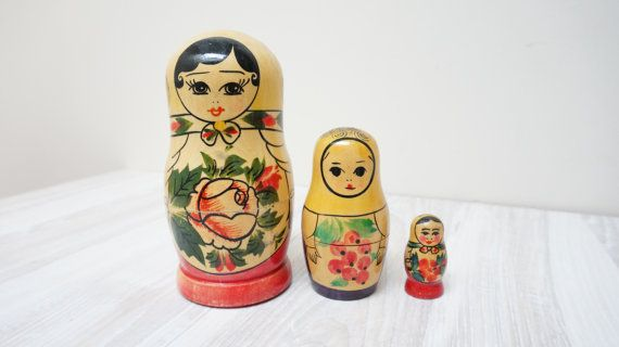 Set of 3 small nesting each into other Matrioskas: Soviet vintage wooden souvenir toy and collectible home decor element from 1970s. Handmade, hand painted. Nest each other, 2 are opening. There is signature on the bottom of the middle one in German: Freundliche Grüße aus Москва (Friendly greetings from Москва). The height of the bigger one is 5 (12.8 cm), of the smaller - 3.5 (8.8 cm), the smallest is about 1.5 (4 cm). Good vintage condition as seen in pictures, slight signs of age.  The…