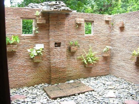 Natural Outdoor Shower Design with Brick Walls and Rock