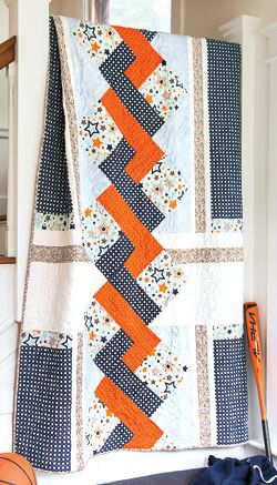 Create a fabulous faux braid with simple blocks in this quilt, Star-Crossed. Challenging, modern quilt pattern.