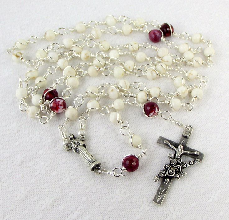 I love all the rosaries from this shop, but I consider St. Rita my patron saint.    St Rita of Cascia Rosary Beads in White Howlite With Bouquet of Roses Crucifix Unbreakable Rosaries. $55.00, via Etsy.