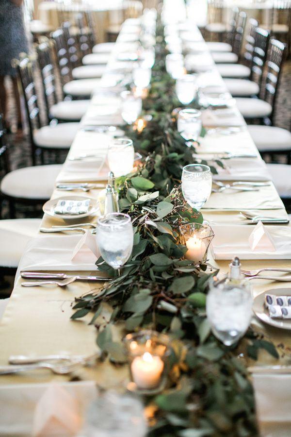 greenery table runner - photo by Aubrey Marie Photography http://ruffledblog.com/romantic-ballroom-wedding-in-tulsa