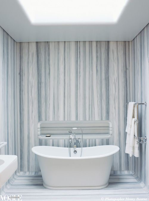 In the London home of designer Marc Newson, a striped marble bathroom makes a strong impression. From a story within Vogue Living May/June 2010. Photograph by Henry Bourne.