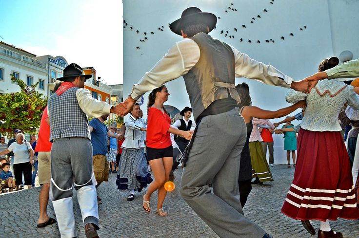 A Hands-On Experience in the #Algarve region - via Crooked Flight 15.10.2015 | #portugal #travel #culture Photo: Men and women dancing a traditional Portuguese dance in Loule, Portugal