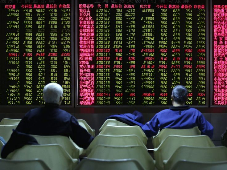 Chinese investors look at a screen showing stock movements at a stock brokerage house in Beijing on Jan. 5, 2016. Shares in China made modest gains in the morning on the day after a plunge in the market triggered a halt to trading. The CSI 300 Index was up 0.79 per cent when the market shut for its lunch break. The index comprises 300 shares from the biggest companies on the Shanghai and Shenzhen exchanges.  How Hwee Young, EPA