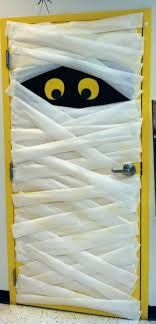Wrap your door like a mummy ~ saw this in an office building a couple of years ago. Very cute and easy idea!