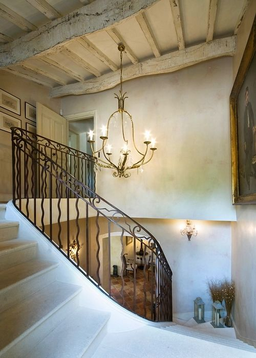 "French Villa----beams like this, wall treatment, little ""nook"" on stairs, lighting, stairs and railing, love it all"
