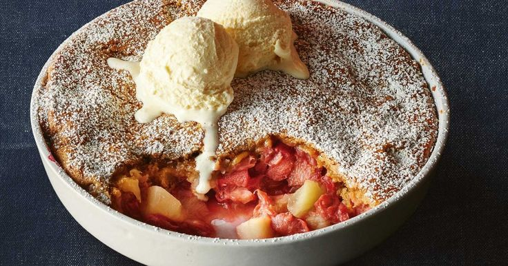Made in the slow-cooker, this apple and rhubarb cobbler features a soft sponge and plenty of sweet fruit.
