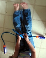 Use a Jump Rope to Teach Tying Shoelaces - Gross motor supports fine motor learning.