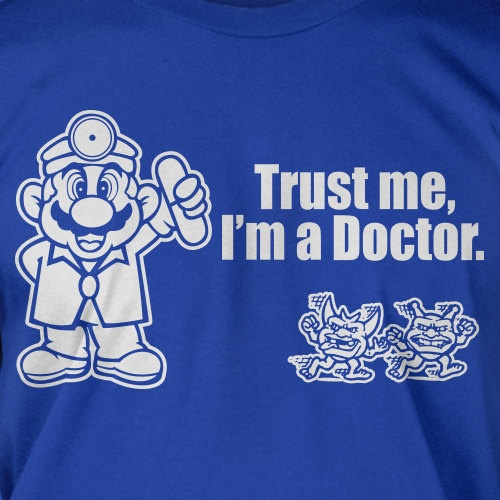 Trust Me I'm A Doctor Mario Nintendo Video Game Geek Nerd Gamer Screen Printed T-Shirt Mens Funny Geek Fathers Day. $14.99, via Etsy.