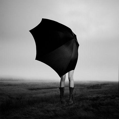 Girl with Umbrella #iain claridge #wind #umbrella #legs