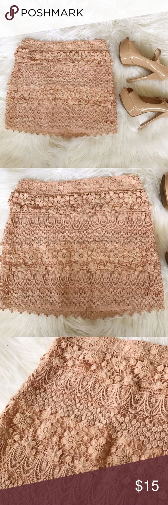 """🎉 HP! 🎉 Rose gold Floral Crotchet Mini Skirt This skirt is beautiful but it's a little big on me. Only worn a few times. 14 1/2"""" layered floral Crotchet fabric. Zips in the back. Pair with nude heels and white button up! Color is pink/tan ish. Not Free People. Only listed for more exposure Free People Skirts Mini"""