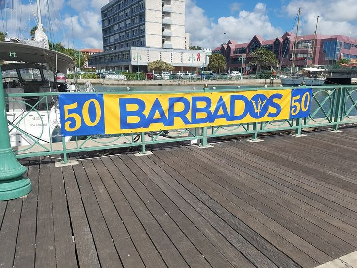A banner near Independence Park in Bridgetown, with the Constitution River in the background, celebrating fifty years of independence for Barbados. /NSC (photo, 2017)