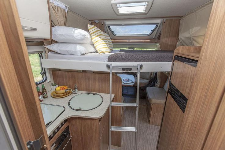 Inside a luxury motorhome: Drop down bed tucks away in ceiling cavity when not in use. Feel free to use this image but give credit to http://smartrv.co.nz/motorhomes-for-sale/german