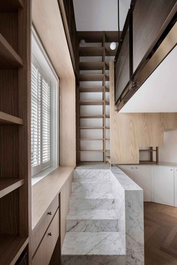 Shanghai Apartment Lined With Floor-To-Ceiling Bookshelves by Atelier TAO+C | Yellowtrace