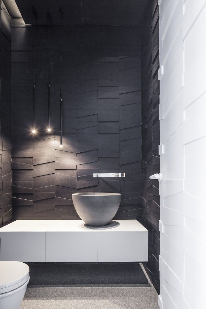 Keeping the benchtop, sink, and the rest of the bathroom simplistic, this allows the 3 dimensional floor to ceiling tiles to be the feature of the bathroom, while not being over the top