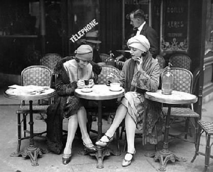 Fancy French ladies drinking coffee.