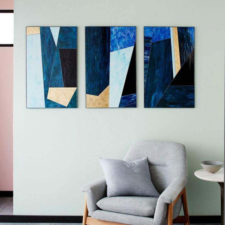 A geometric take on stained glass this bold blue gold triptych is a modern way to spruce up your walls