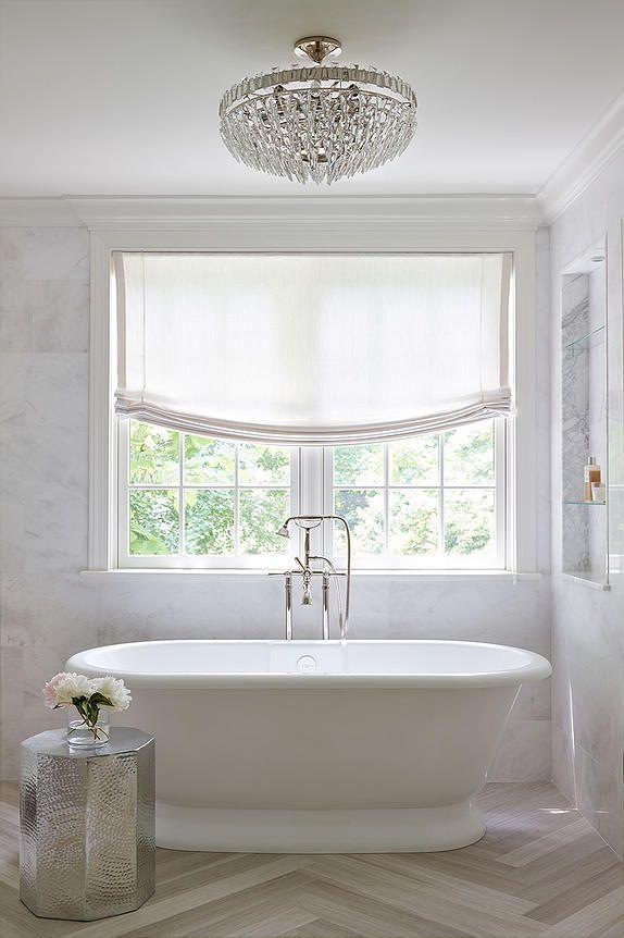 Sophisticated elegant bathroom features a crystal semi
